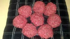 spiced meat formed into patties raw