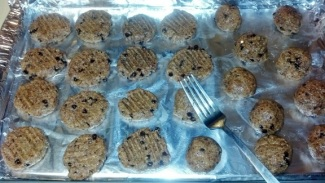 rolled into balls, flatten with fork  on baking sheet
